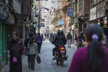 overpopulation: KATHMANDU, NEPAL - FEBRUARY 10, 2015: The streets of Kathmandu, Nepal, near Dubar square. Masses of people, rickshaws and Motorbikes crowd through the streets, 10, 2015 in Kathmandu, Nepal.