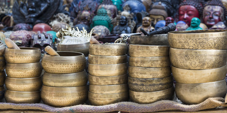 singing bowls: Several singing bowls displayed at a market in Kathmandu, Nepal