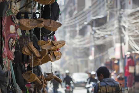 nepali: Traditional nepali hempen shoes and vest leaning against a red wall in a shop in Durbar Square-Kathmandu-Nepal.