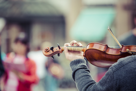 fiddles: Violin close up with hand Stock Photo
