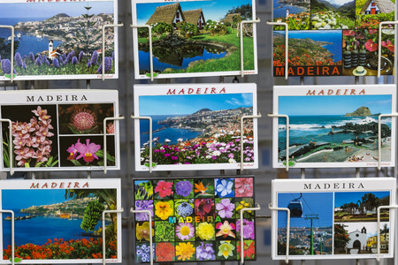 june 25: MADEIRA - JUNE 25, : Colorful Madeira postcards offered for sale at the Funchal town on June 25, 2015 in Funchal, Portugal. It is a popular souvenir for tourists.