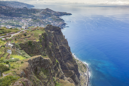 lobos: Amazing view from the highest Cabo Girao cliff on the beach, ocean water and Camara de Lobos town, Madeira island, Portugal