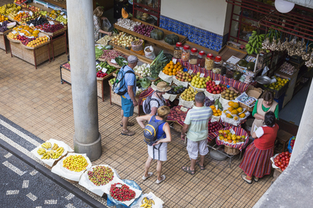 june 25: FUNCHAL, PORTUGAL - JUNE 25: Fresh exotic fruits in Mercado Dos Lavradores.on June 25, 2015 in Madeira Island, Portugal.
