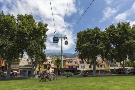 june 25: FUNCHAL, PORTUGAL - JUNE 25: Cable car to Monte on June 25, 2015 in Funchal, Madeira island, Portugal.
