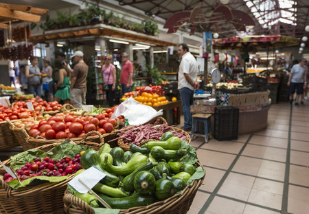 anona: FUNCHAL, PORTUGAL - JUNE 25: Fresh exotic fruits in Mercado Dos Lavradores.on June 25, 2015 in Madeira Island, Portugal.