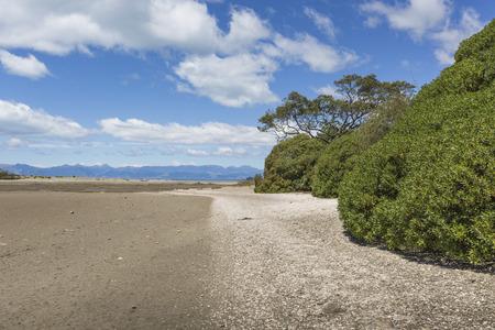 placid water: Calm seas of the Abel Tasman National Park, South Island, New Zealand