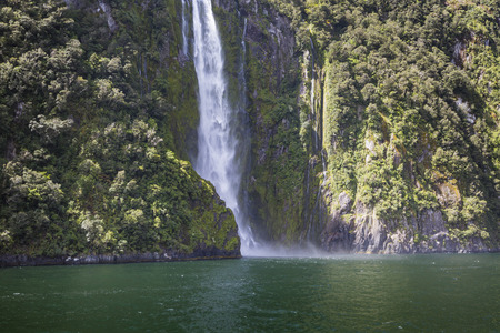fiordland: Incredible Stirling Falls with double rainbow, Milford Sound, Fiordland, South Island, New Zealand