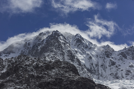 milford: Snow mountains along Milford Sound road New Zealand