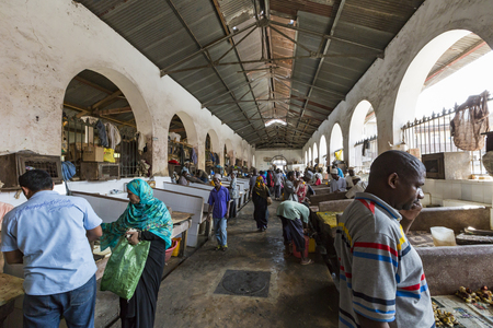 city fish market: STONE TOWN, ZANZIBAR - JANUARY 15: Sellers offer fresh fish and seafood in the city market on 15 January 2015 in Stone Town, Tanzania.