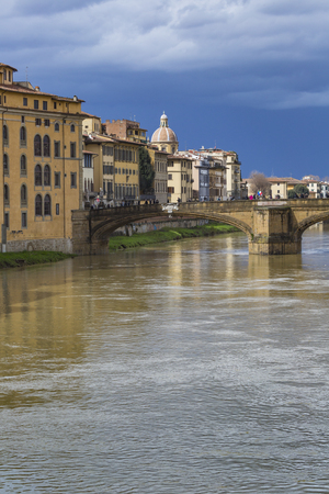 trinita: FLORENCE, ITALY - MARCH 07: Ponte Santa Trinita bridge over the Arno River shown on March 07, 2016 in Florence, Italy. The Ponte Santa Trinita is the oldest elliptic arch bridge in the world