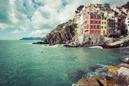 RIOMAGGIORE, ITALY - 05 MARCH, 2016 : Beautiful seaside village in summertime, Riomaggiore, Cinque Terre National park, Ligurian region, Italy.