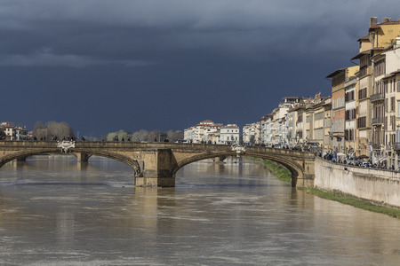 sightseeng: FLORENCE, ITALY - MARCH 07: Ponte Santa Trinita bridge over the Arno River shown on March 07, 2016 in Florence, Italy. The Ponte Santa Trinita is the oldest elliptic arch bridge in the world