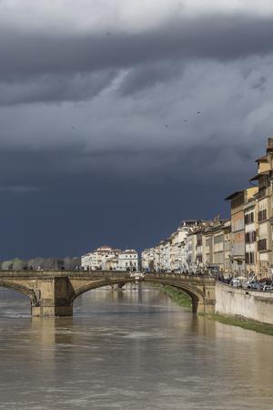 elliptic: FLORENCE, ITALY - MARCH 07: Ponte Santa Trinita bridge over the Arno River shown on March 07, 2016 in Florence, Italy. The Ponte Santa Trinita is the oldest elliptic arch bridge in the world