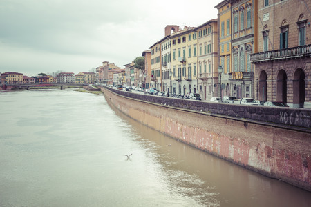 river arno: PISA, ITALY - MARCH 10, 2016: River Arno floating through the medieval city of Pisa in Italy, on March 10, 2016 Editorial