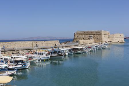 old ship: Fishing boats in port in Heraklion, Crete Island, Greece Editorial
