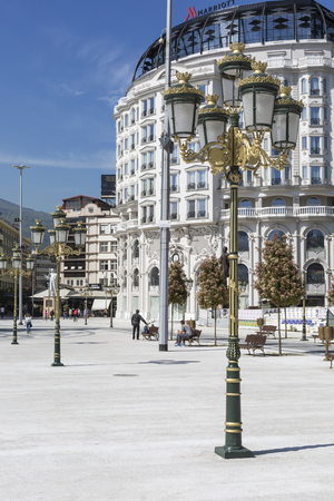 alexander the great: SKOPJE, MACEDONIA - APRIL 14, 2016: Square Makedonia, the capitals main square, with people passing by and Alexander the Great statue