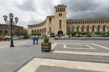 xx century: YEREVAN, ARMENIA-MAY 02: Republic Square and Ministry of Foreign Affairs of Armenia on May 02, 2016. Building is located in center of Yerevan. It was erected in the 40s. XX century Editorial
