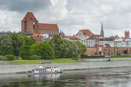 mediaeval: TORUN, POLAND - MAY 18, 2016: Torun in Poland, Old Town skyline, fortified medieval city, river view. Editorial