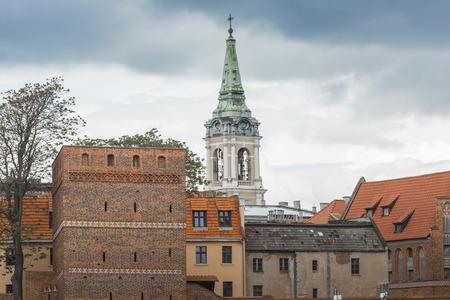 torun: TORUN, POLAND - MAY 18, 2016: Torun in Poland, Old Town skyline, fortified medieval city, river view. Editorial
