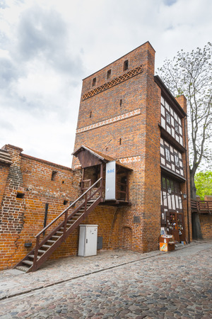 stare miasto: TORUN, POLAND - MAY 18, 2016: Medieval leaning defence tower of Torun displaced 1.5 meters as measured from the top