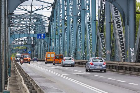 torun: TORUN, POLAND - MAY 18, 2016: Poland - Torun famous truss bridge over Vistula river. Transportation infrastructure.