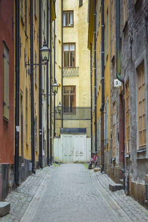 cobblestone road: Colorful rustic Alley with Cobblestone road with a surrealistic feeling, Old town, Stockholm - Sweden.
