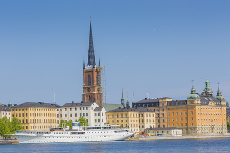 stan: Scenic panorama of the Old Town (Gamla Stan) pier architecture in Stockholm, Sweden Editorial