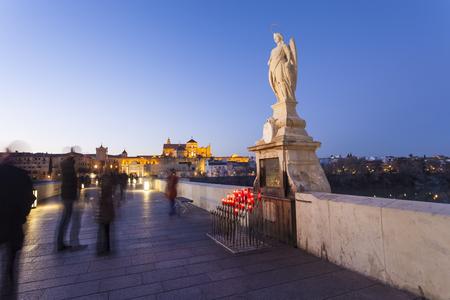 san rafael: CORDOBA - SPAIN - JUNE 10, 2016 : San Rafael statue of the Roman bridge in Cordoba - Spain