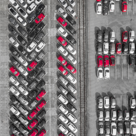 new car lot: Aerial view lot of vehicles on parking for new car. Black and White selective red colour.