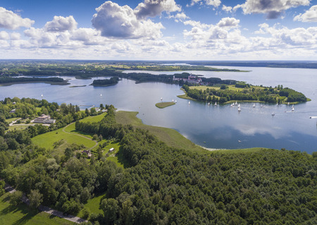 masuria: Lake Wigry National Park. Suwalszczyzna, Poland. Blue water and whites clouds. Summer time. View from above. Stock Photo