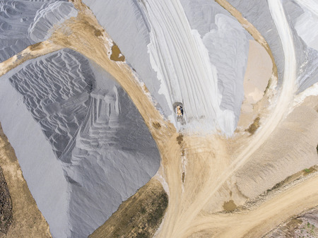source of iron: Aerial view over the building materials processing factory. Sand mine. View from above.