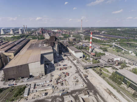smokestacks: Steel factory with smokestacks at sunny day.Metallurgical plant. steelworks, iron works. Heavy industry in Europe.Air pollution from smokestacks, ecology problems. Industrial landscape.View from above. Stock Photo