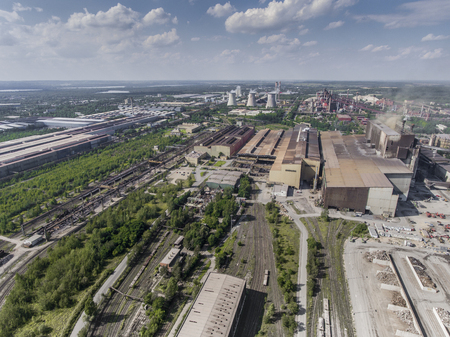 steel works: Steel factory with smokestacks at sunny day.Metallurgical plant. steelworks, iron works. Heavy industry in Europe.Air pollution from smokestacks, ecology problems. Industrial landscape.View from above. Stock Photo