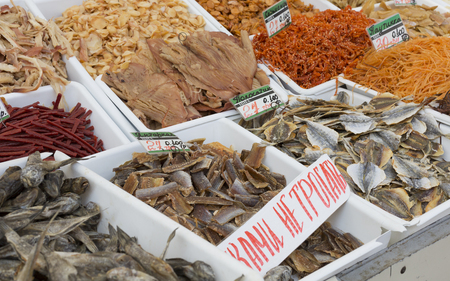 campesino: Dried salted fish at a farmers market. The price tags on each product with the title.