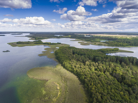 Lake Wigry National Park. Suwalszczyzna, Poland. Blue water and whites clouds. Summer time. View from above. Stock Photo