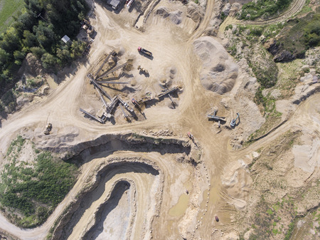 sand pit: Mining quarry with special equipment, open pit excavation. Sand mine. View from above.