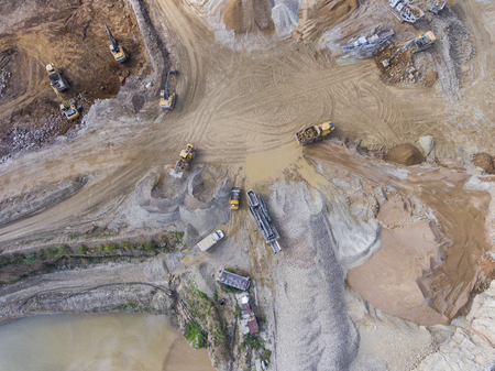tailings: Mining quarry with special equipment, open pit excavation. Sand mine. View from above.