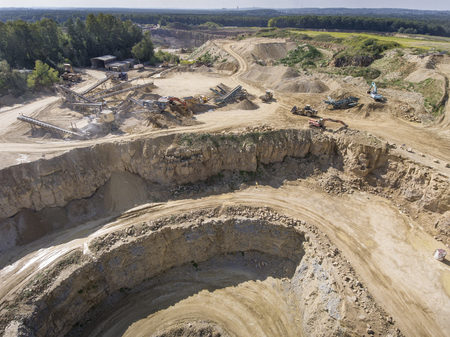 goldmine: Mining quarry with special equipment, open pit excavation. Sand mine. View from above.