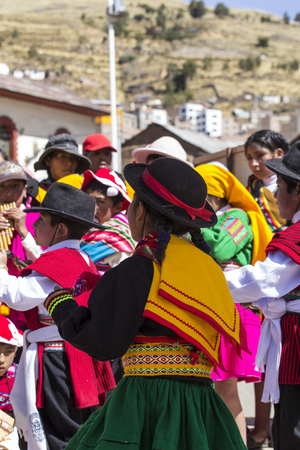 religious clothing: Puno, Peru - August 20, 2016: Native people from peruvian city dressed in colorful clothing perform traditional dance in a religious celebration. Peru, South America.