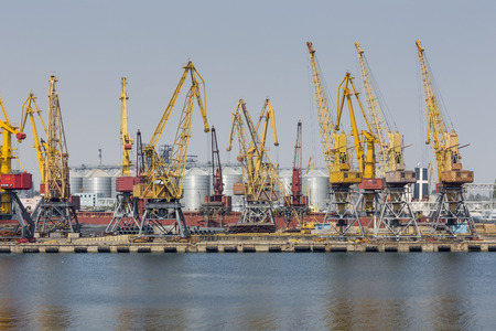 Odessa, Ukraine - July 30, 2016: Container cranes in cargo port terminal, cargo cranes without job in an empty harbor port. A crisis. Defaulted paralyzed entire economy of state Editorial