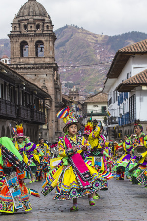 CUSCO - PERU - JUNE 06, 2016 : Peruvian dancers at the parade in Cusco. People in traditional clothes.