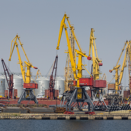 paralyzed: Odessa, Ukraine - July 30, 2016: Container cranes in cargo port terminal, cargo cranes without job in an empty harbor port. A crisis. Defaulted paralyzed entire economy of state Editorial