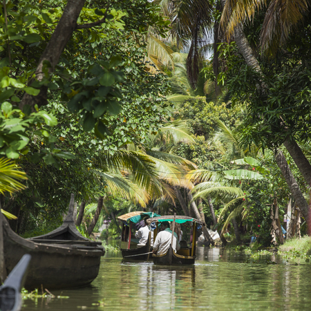 navigable: ALLEPPEY, KERALA, INDIA - AUGUST 16, 2016: Unidentified indian people in small boat in backwaters. Kerala backwaters are both major tourist attraction and integral part of local people life in Kerala