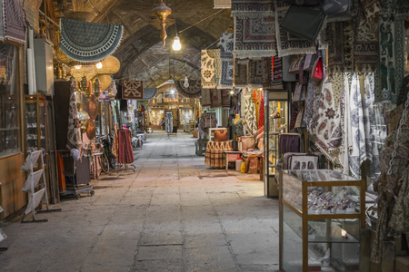 isfahan: ISFAHAN, IRAN - OCTOBER 06, 2016:  traditional iranian souvenirs in market (Bazaar) in Isfahan, Iran. Bazaar of Isfahan is the most important tourist attraction. Editorial