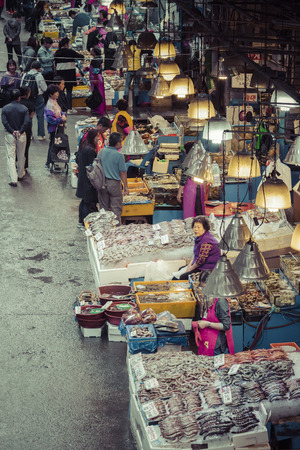 fisheries: SEOUL - OCTOBER 23, 2016: View of shoppers at Noryangjin Fisheries Wholesale Market The 24 hour market has over 700 stalls selling fresh and dried seafood.