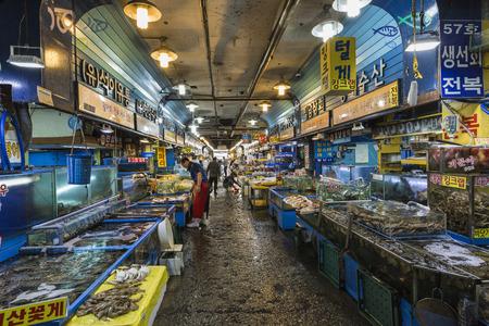 SEOUL - OCTOBER 23, 2016: Vendors selling fish at Garak Market in Seoul, South Korea