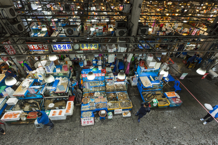 fisheries: SEOUL - OCTOBER 23, 2016: Aerial view of shoppers at Noryangjin Fisheries Wholesale Market The 24 hour market has over 700 stalls selling fresh and dried seafood.