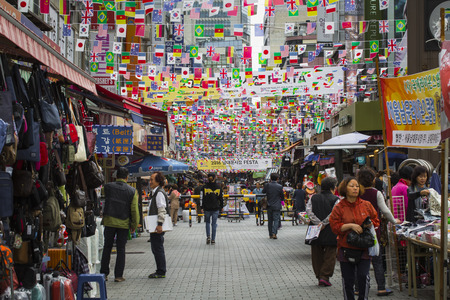 city fish market sign: SEOUL - OCTOBER 21, 2016: Namdaemun Market in Seoul. Namdaemun Market is a large traditional market in Seoul, South Korea. Editorial