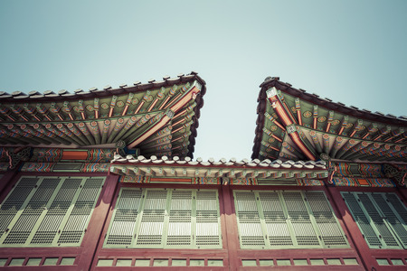 korean style house: Detail of Traditional Korean Roof, Colourful Decorated Ornament for Ancient Korean Palace or Temple at Seoul, South Korea. Editorial