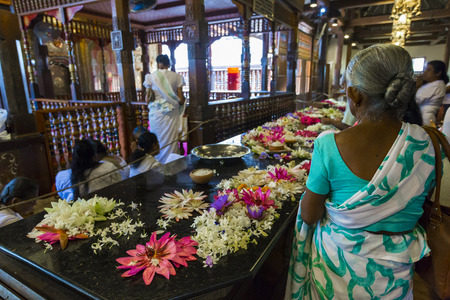 KANDY, SRI LANKA - DECEMBER 01:, 2016: Temple Of The Sacred Tooth RelicThe inside view. People bring flowers to the Temple. Kandy, Sri Lanka Editorial